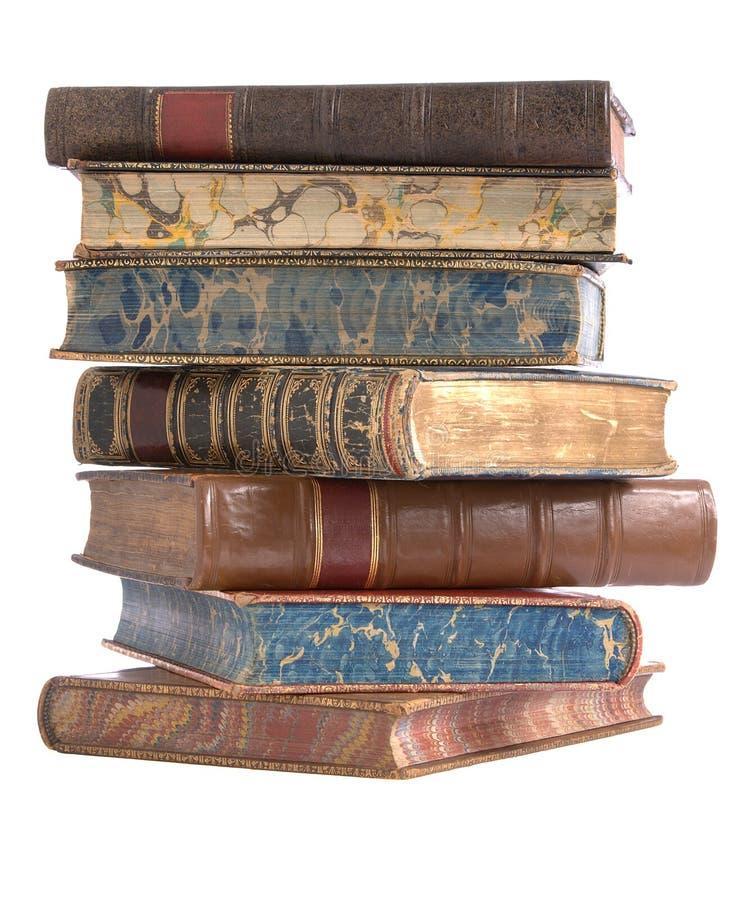 Pilha de livros encadernados de couro velhos fotos de stock