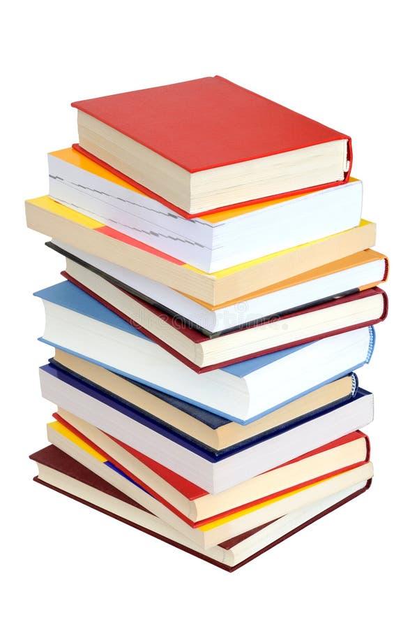 Pilha de livros no branco fotografia de stock