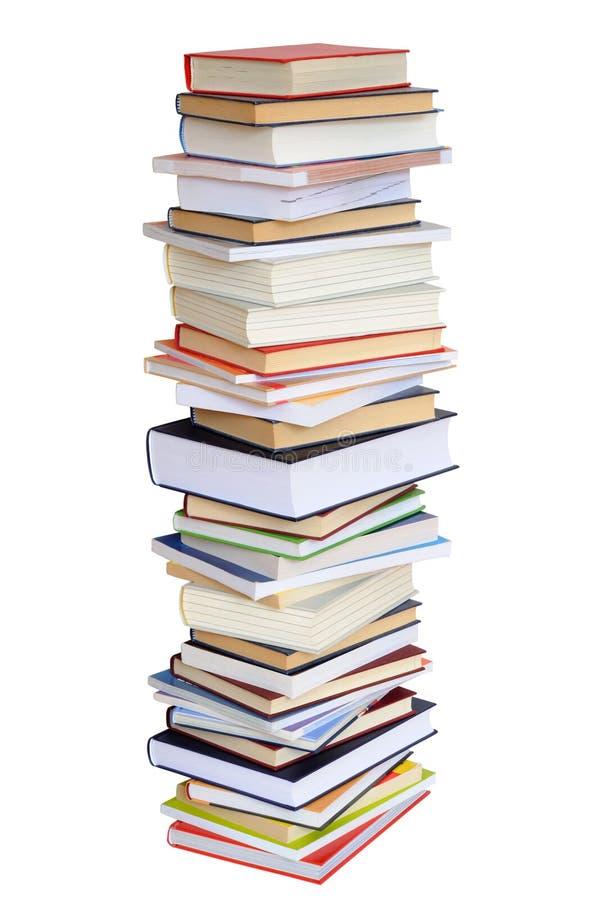 Pilha de livros no branco imagem de stock royalty free