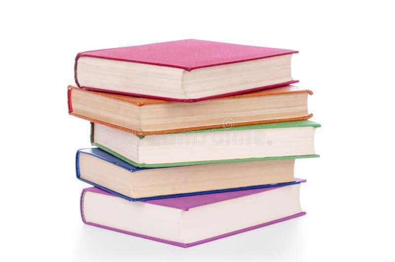 Pilha de livros velhos isolados no branco foto de stock royalty free