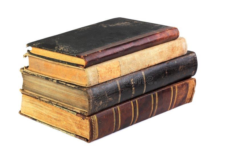 Pilha de livros velhos isolados no branco fotografia de stock royalty free