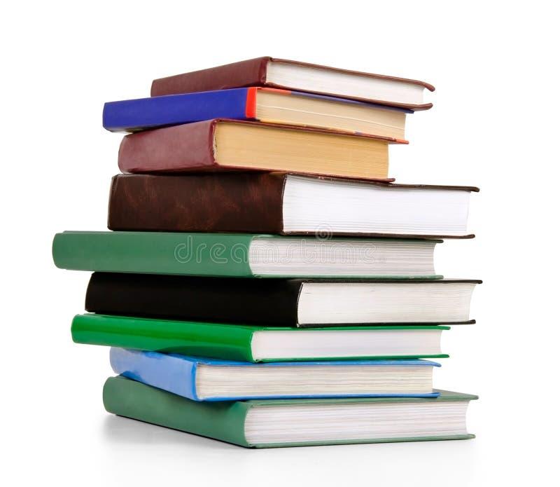 Pilha de livros velhos isolados no branco foto de stock