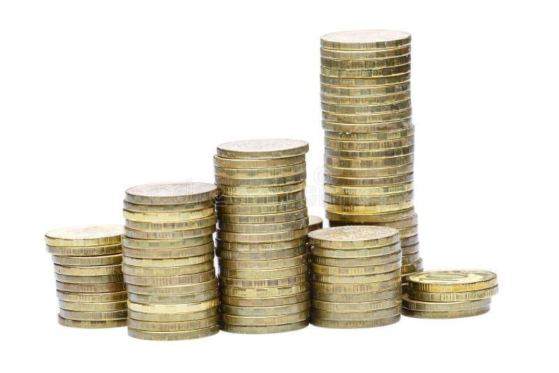 Pilha de moedas de ouro isoladas no branco fotos de stock royalty free