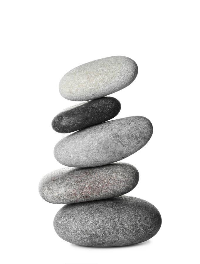 Pilha de pedras dos termas no branco imagens de stock