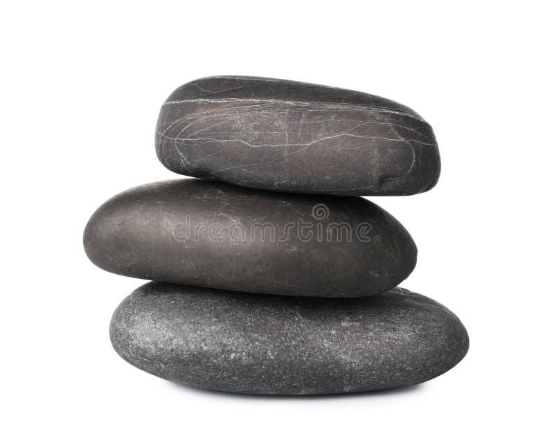 Pilha de pedras dos termas no branco imagem de stock