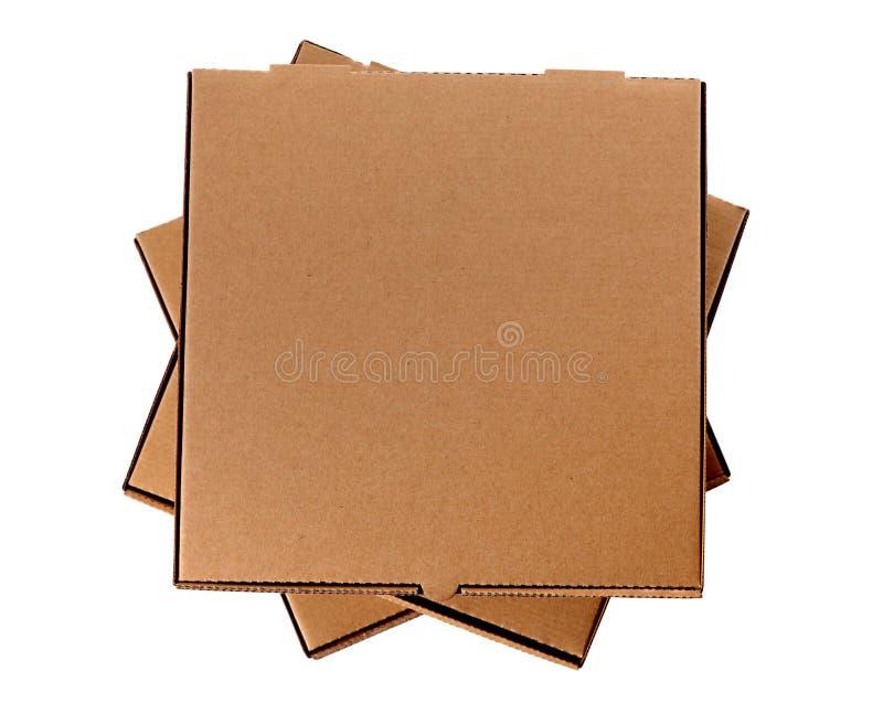 Pilha de três caixas marrons da pizza foto de stock royalty free