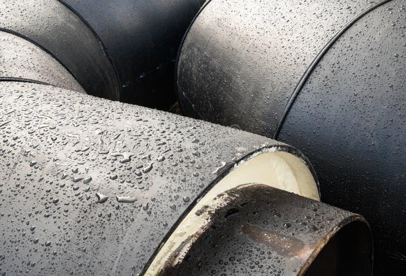 Pilha de tubos cinzentos novos das tubulações do metal fotografia de stock royalty free
