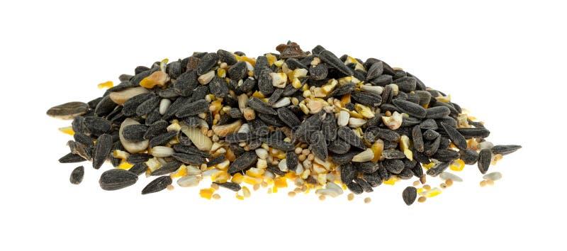Pilha do alimento de pássaro com sementes e painço de girassol imagem de stock royalty free