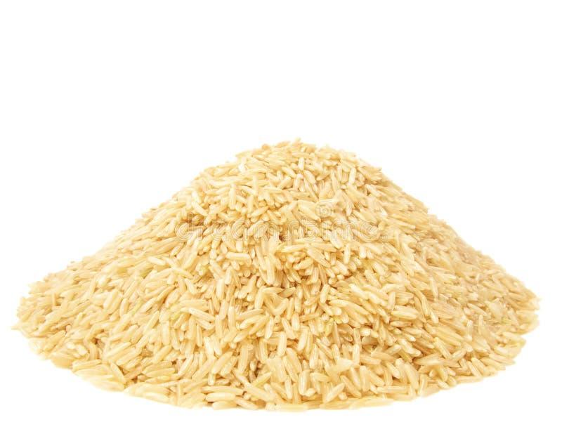 Pilha do arroz integral imagem de stock