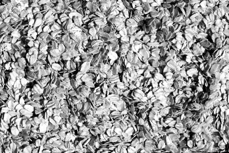 Pilha do close-up da farinha de aveia em preto e branco imagem de stock royalty free