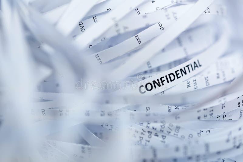 Pilha do papel shredded - confidencial imagens de stock