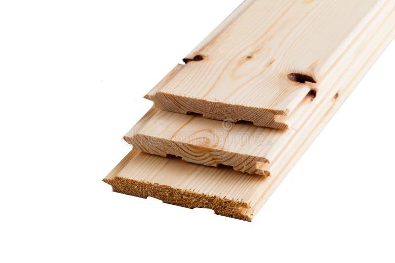 Pilha dobrada placa do pinho carpentry As placas de madeira dobraram-se em se fotografia de stock royalty free