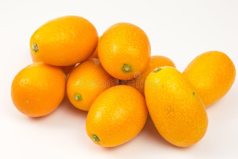 Pilha dos kumquats fotografia de stock