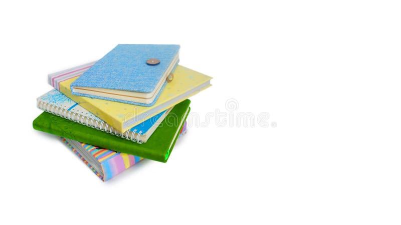 Pilha dos livros e dos cadernos fotos de stock