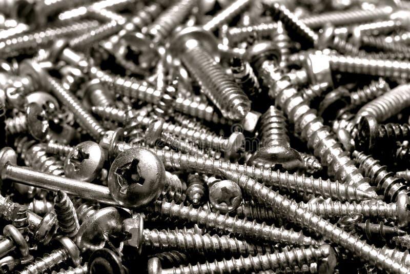 Pilha dos parafusos de máquina da ferragem fotografia de stock royalty free