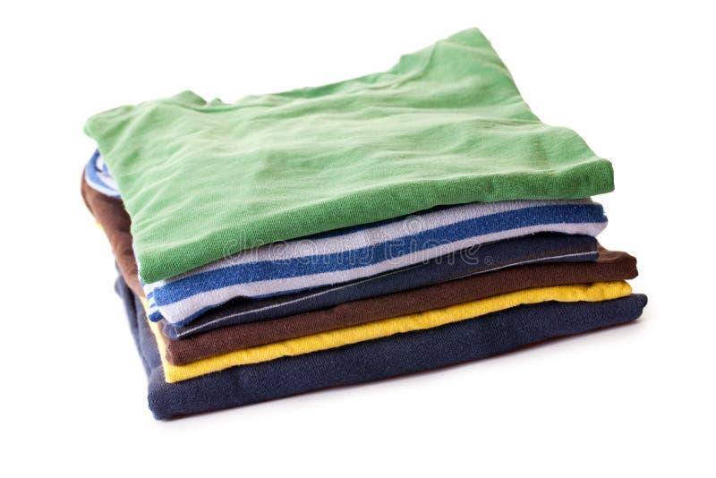 Pilha dos t-shirt fotografia de stock