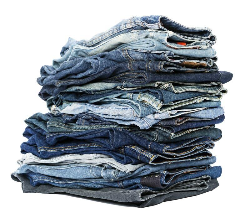 Pilha isolada das calças de brim foto de stock