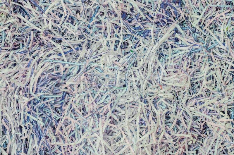 Pilha Tangled do papel cortada em partes pequenas Fundo de superfície de papel do papel de parede fotos de stock
