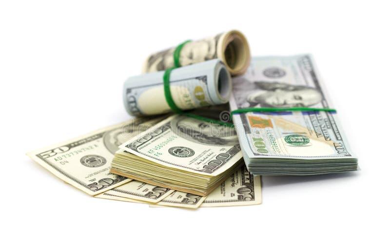 Pilhas de cem dólares fotografia de stock royalty free