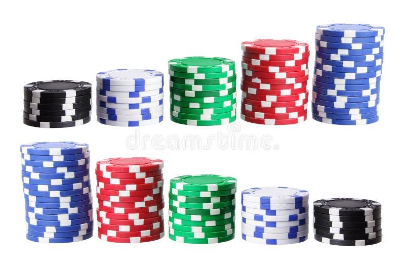 Pilhas de microplaquetas do póquer fotos de stock royalty free