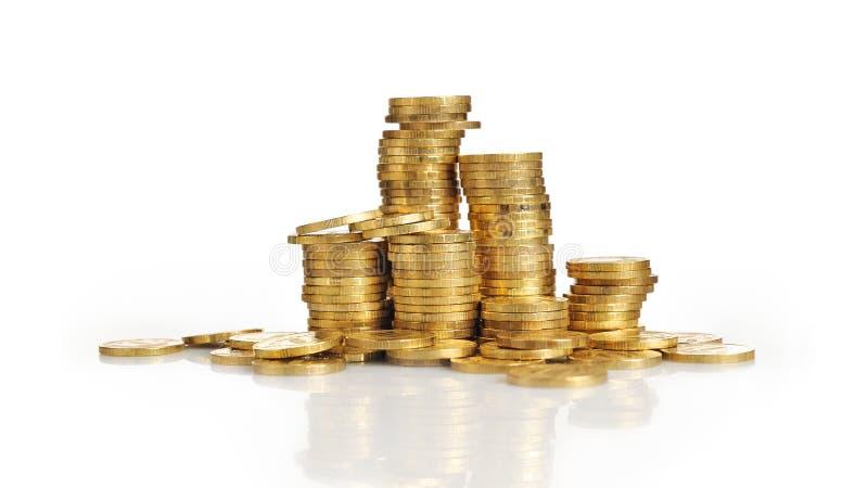 Pilhas de moedas de ouro fotografia de stock