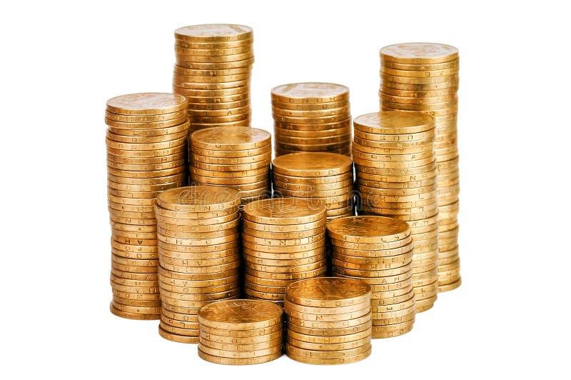 Pilhas de moedas no branco foto de stock royalty free