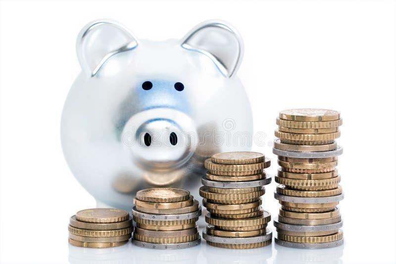 Pilhas do banco Piggy e da moeda fotos de stock royalty free
