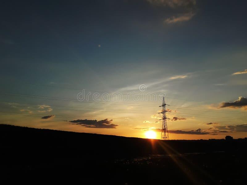 Pilier de puissance sur un fond de coucher du soleil photos libres de droits