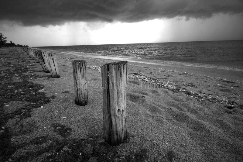 Pilings in Storm at Beach. Storm coming in at Manasota Beach, Englewood, FL royalty free stock photography