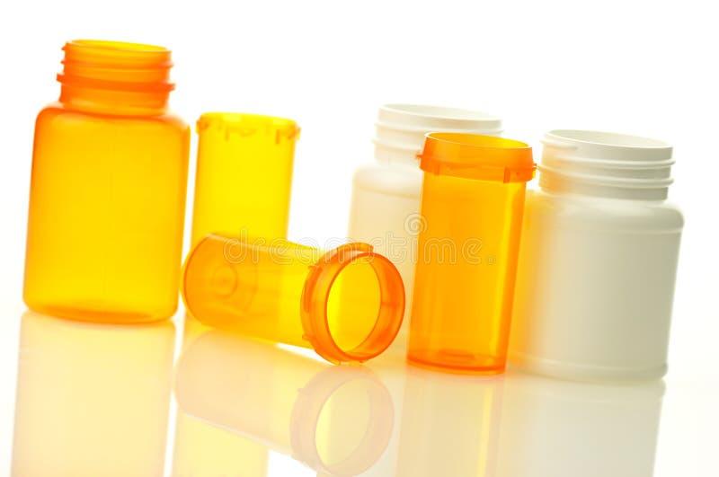Pill bottles. Empty pill bottles on white background stock image