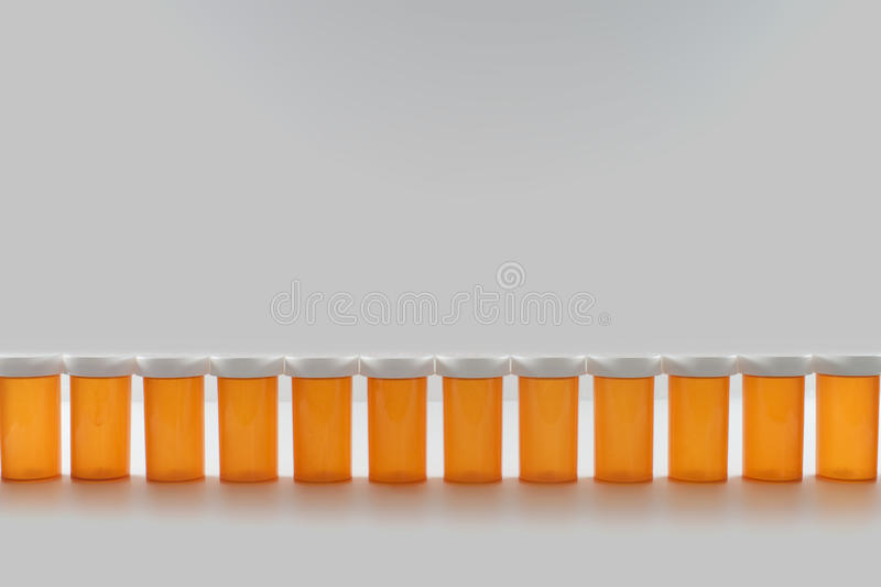 Pill Bottles in a Row stock photography