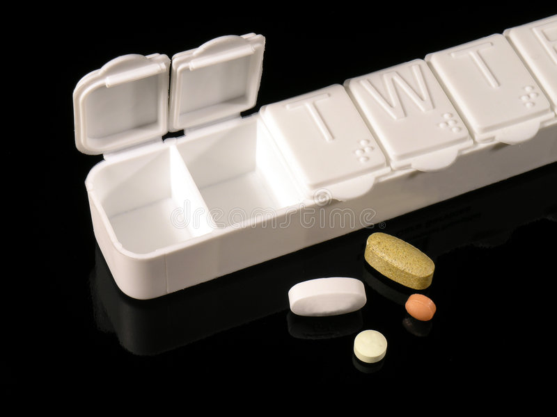 Pill Box and Pills royalty free stock photography