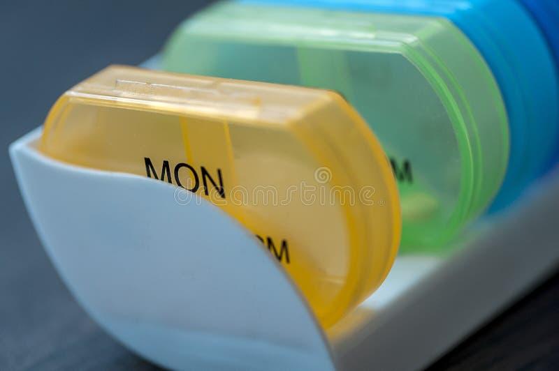 Daily pill boxes. Close-up of medicine dose box. Prescription pills in a pill box stock photos