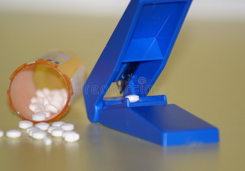Pill cutter royalty free stock image