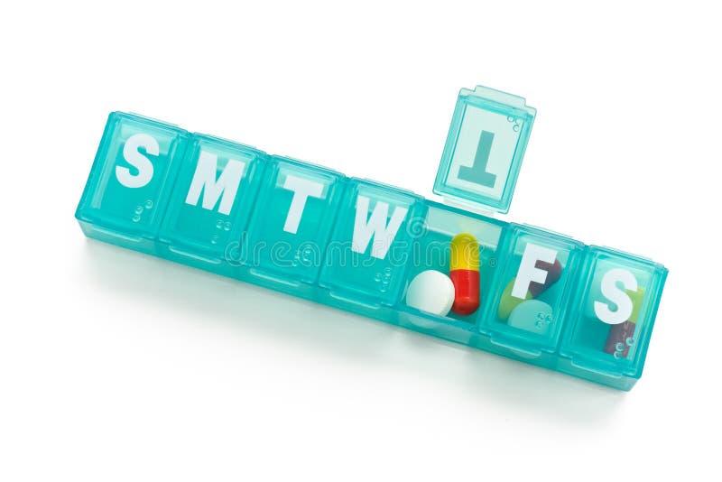 Pill dispenser stock photos