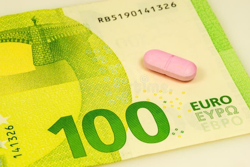 Pill on euro bills. In a closeup royalty free stock photos