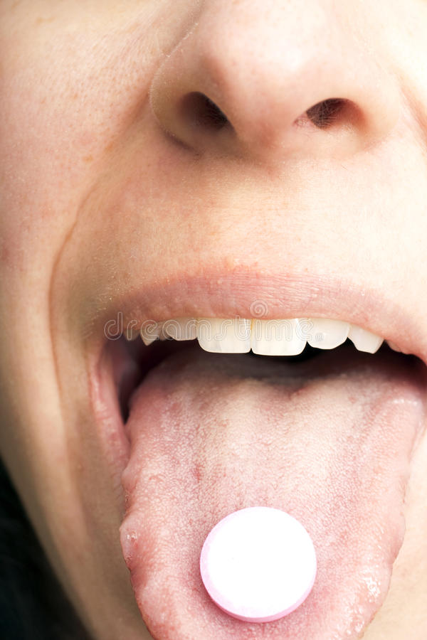 Pill on Tongue stock images