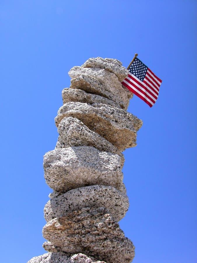 Pillar of rocks with USA flag stock photo