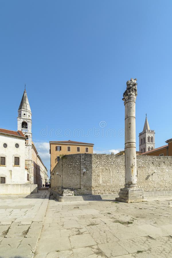 Pillar of shame Zadar. Pillar of shame ,St Elias Church and The Cathedral of St. Anastasia on the city of Zadar, Croatia stock photo
