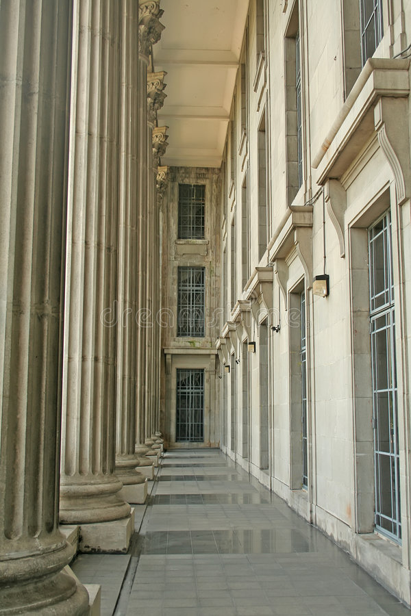 Pillar Walk Way in a Justice Court royalty free stock image