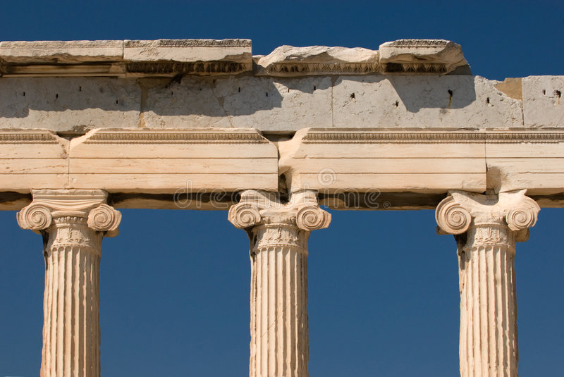 Pillars at the Acropolis. These pillars hold up the Erectheum Temple in Athens, Greece royalty free stock photo