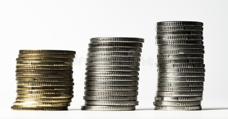 Pillars of coins. Three pillars with coins stock photography
