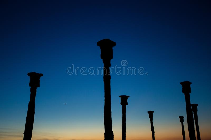 The pillars dock stand with sunset view on Tedys Beach. At Kupang, Indonesia stock photo
