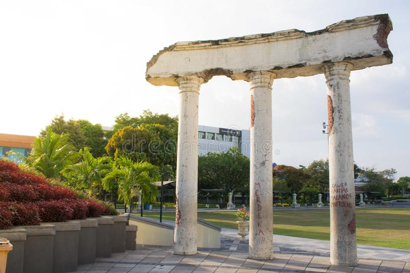 Surabaya, Indonesia - October 2018: The white pillars at the entrance to the Heroes Museum in Surabaya, Indonesia. While pillars at the entrance to the Heroes stock photos