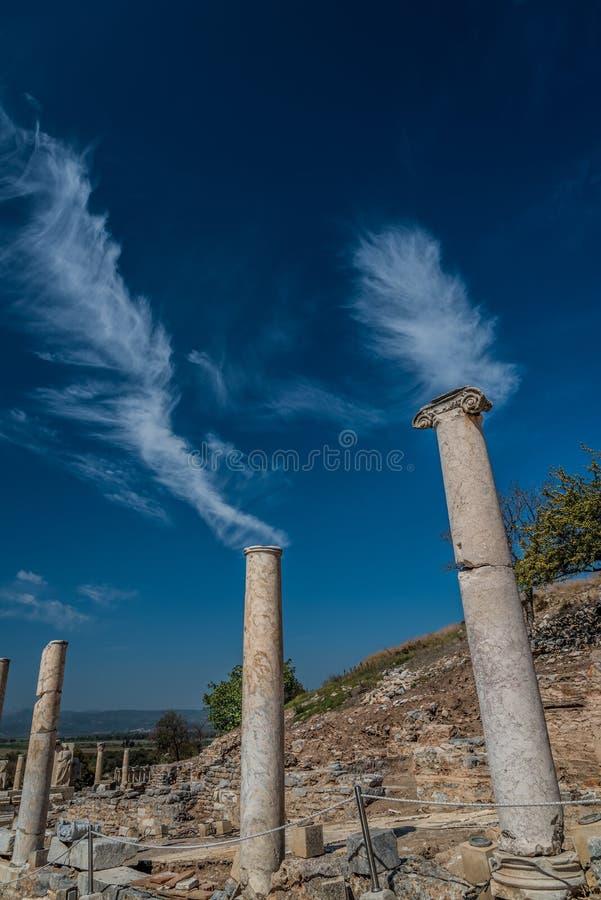 Pillars in Ephesus, Selçuk, Turkey. Pillars in Ephesus with the clouds, Selçuk, Turkey royalty free stock photo