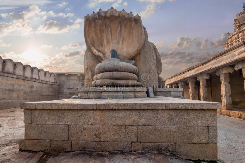 Pillars of a hindu temple with beautiful sky and cloud backdrop, shiva linga at lepakshi temple royalty free stock photo