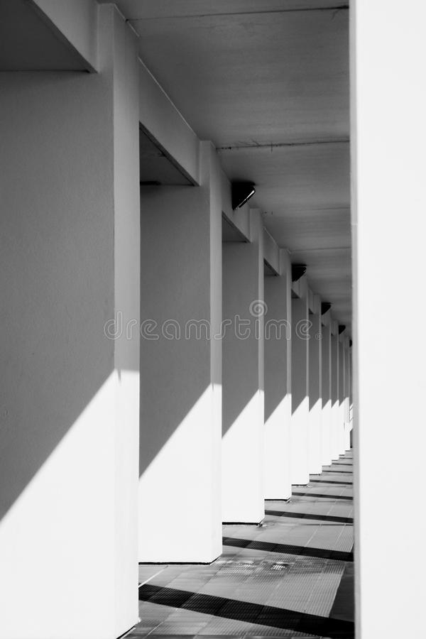 Pillars lined up towards infinity in black and white stock images