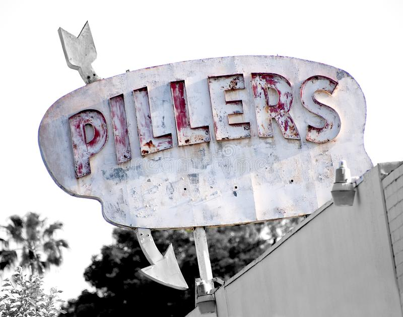 Pillars vintage distressed shabby chic architectural wood sign royalty free stock photo