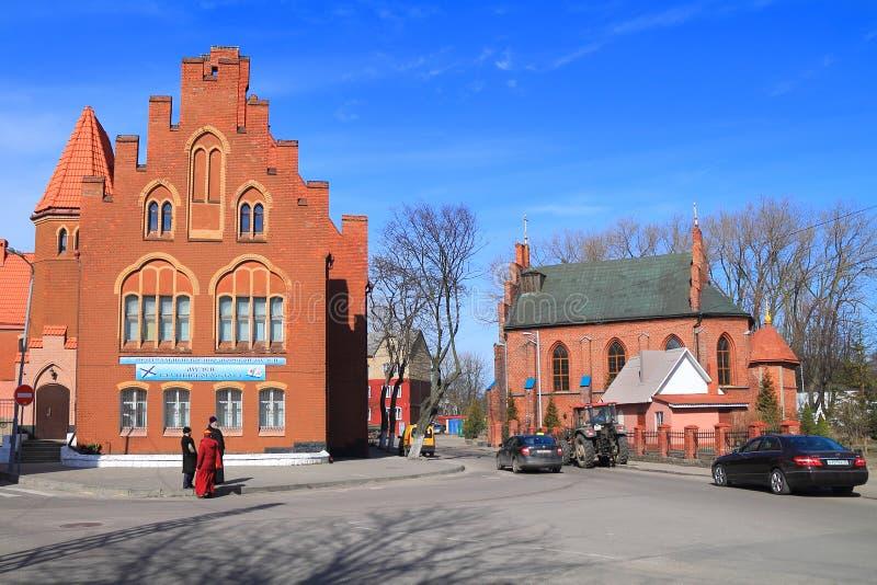 Pillau前城市法院1903年建筑和Pillau ` s路德教会1866建筑 免版税库存图片