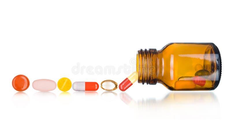 Pillen die uit pillenfles morsen royalty-vrije stock foto